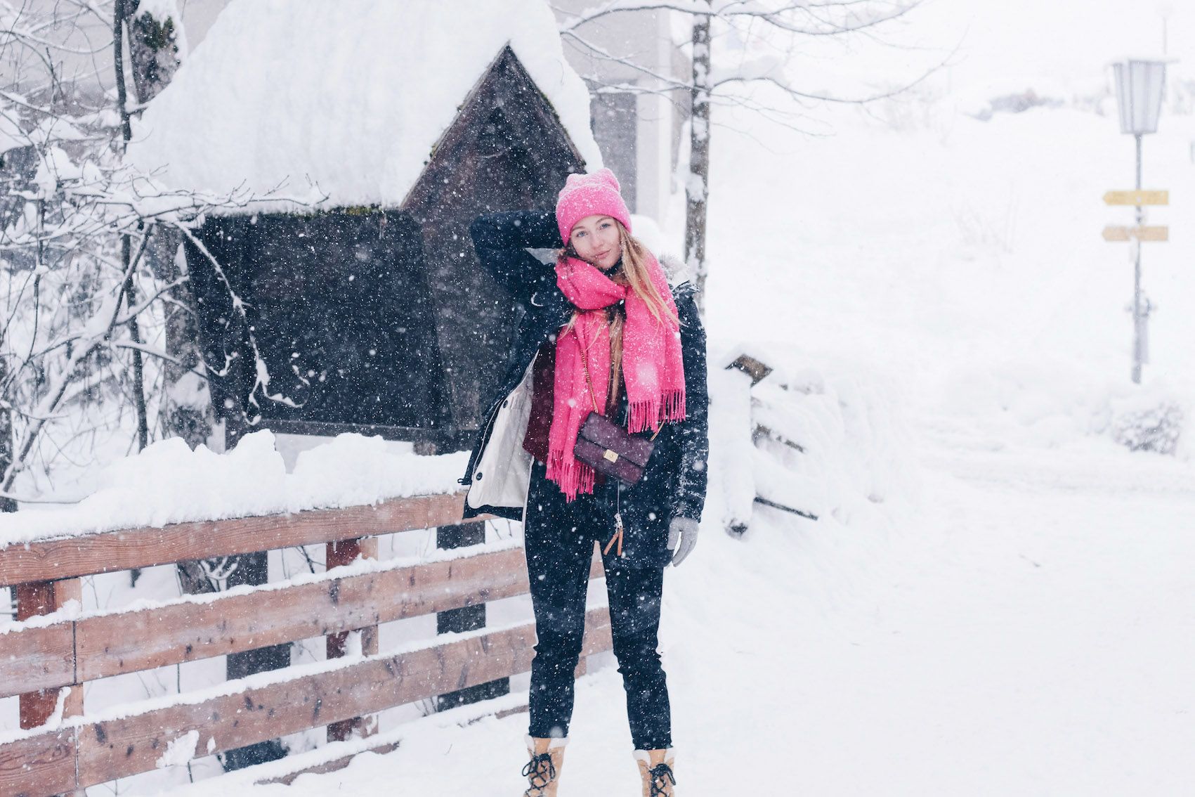 PINK SCARF, PINK HAT AND SOREL BOOTS