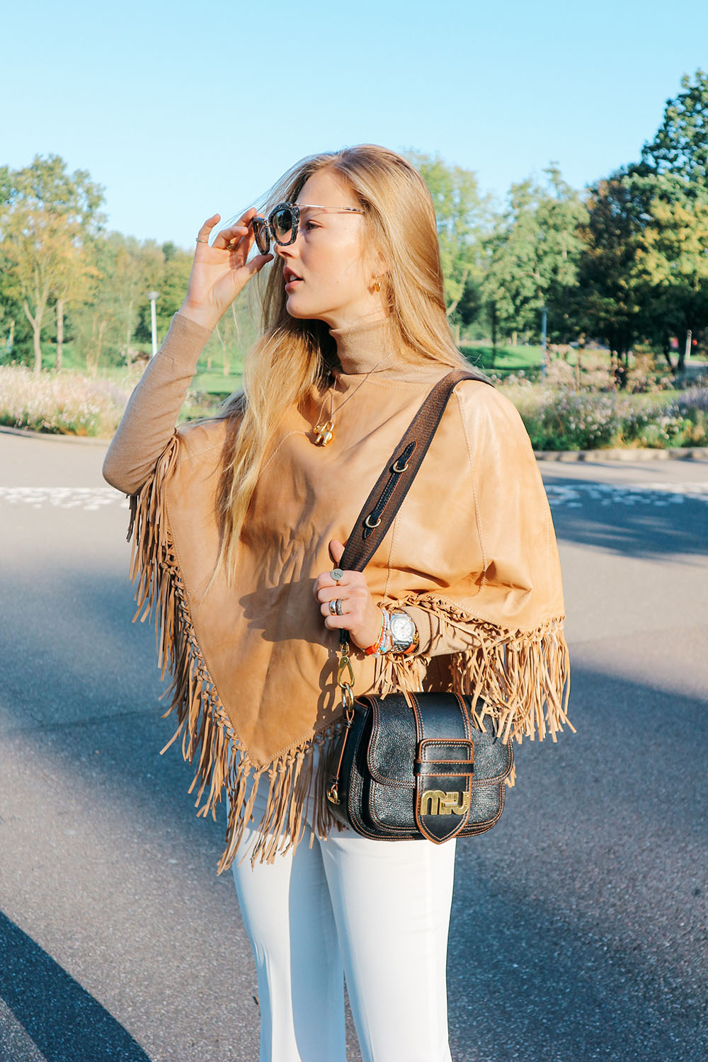 floortjeloves, leather fringed poncho, fringed poncho, poncho, leather poncho, white flare, miumiu, miu miu, miu miu bag, Louis Vuitton, Louis Vuitton boots